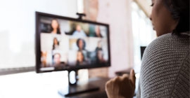 A woman attends a virtual meting